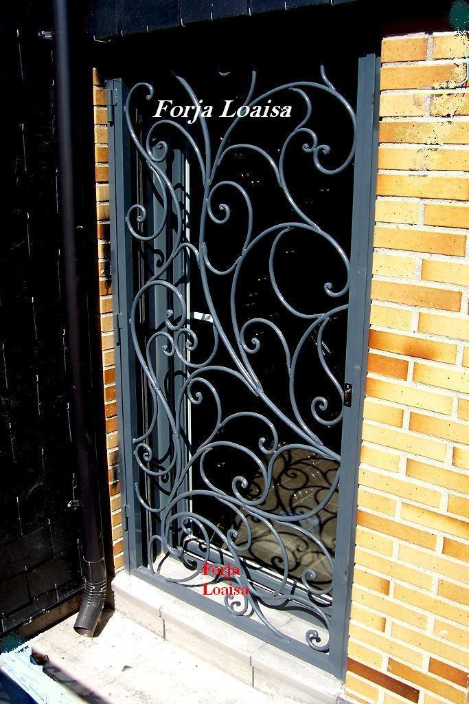 Puertas de hierro forja loaisa for Puertas decorativas para interiores