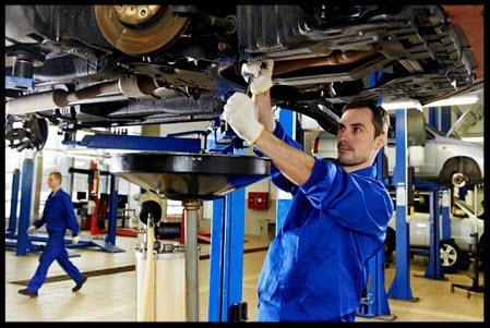 auto mechanic repairing a car in a repair shop