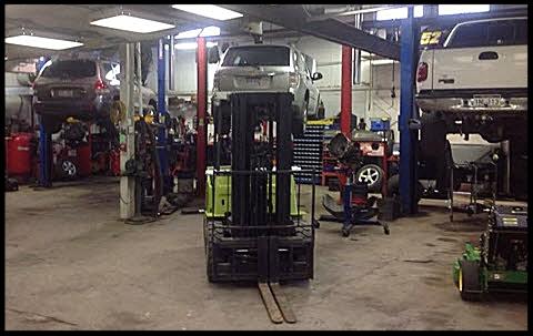 cars on lifts in Clarksburg repair shop