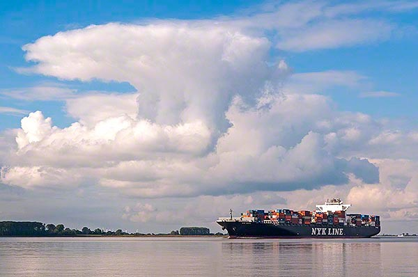 big containervessel on the river elbe