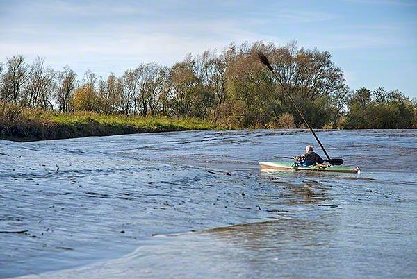 kajak in the tideway of elbe river