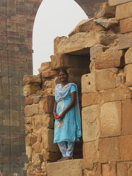 2013 A Woman wearing her holiday finery at Qutub Minar in Delhi
