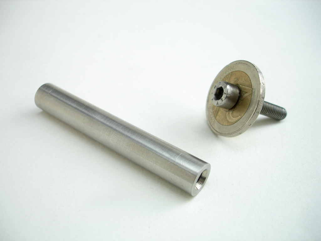 Lathe turned barrel - 65mm x 10mm stainless steel rod. Barrel screw is cap screw M5 x 25 & coin with knurled edge.