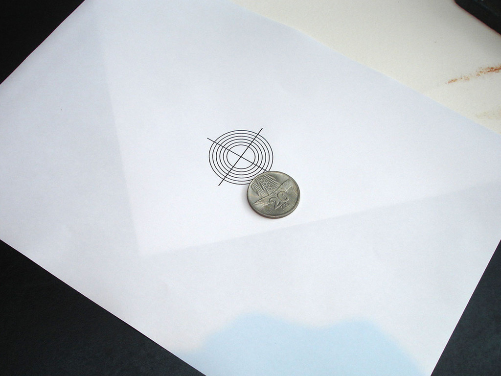 Print out circle centre template for marking coin for really accurate drilling of centre.