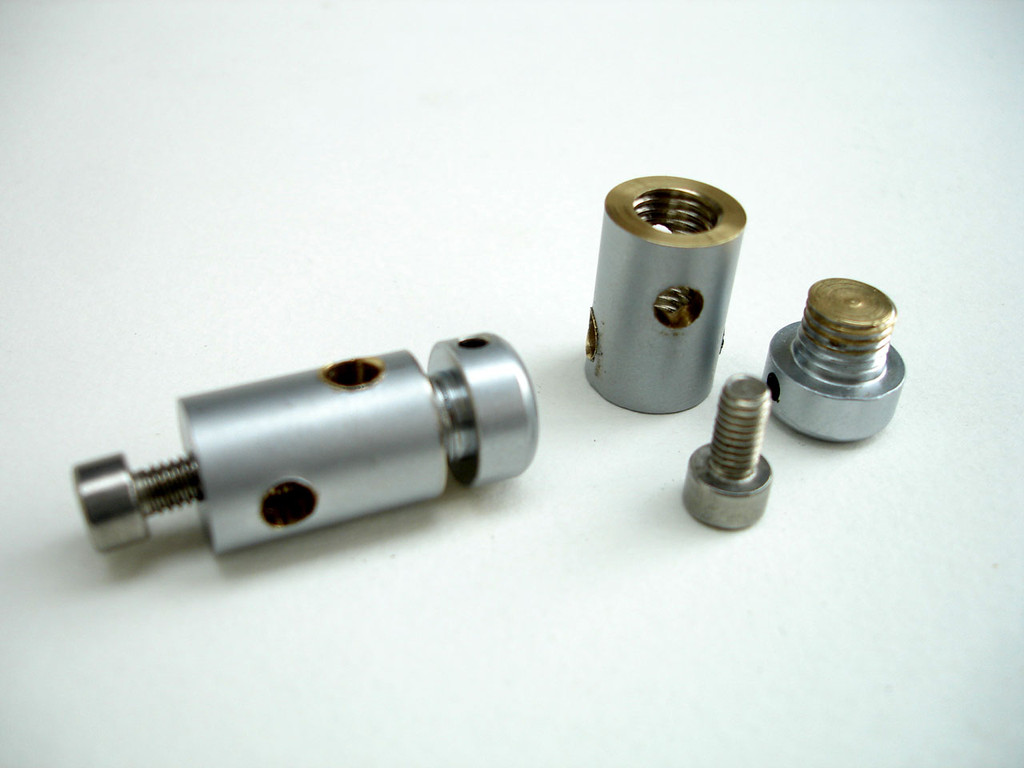 Arm / needle shaft connector - WM 12 standoff fitting. See parts list for supplier.