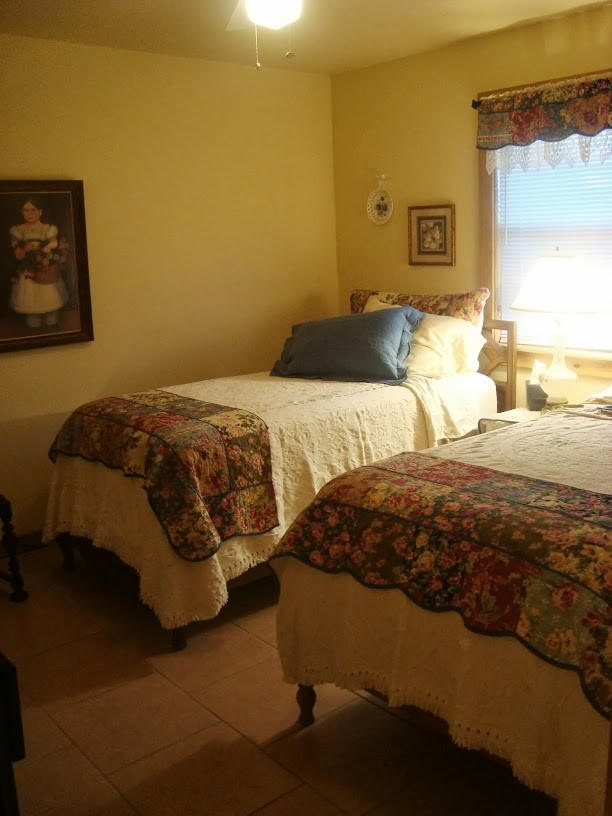 twin beds in the third bedroom with bathroom just across the hall