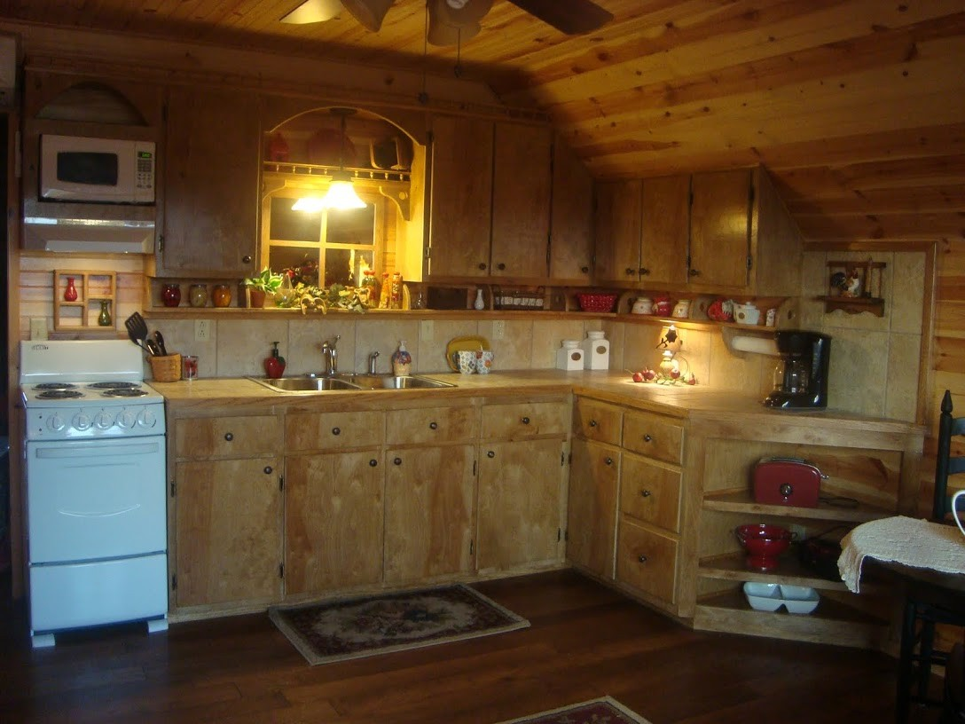 completely equipped kitchen with stove,oven, microwave, fridge and essentials.