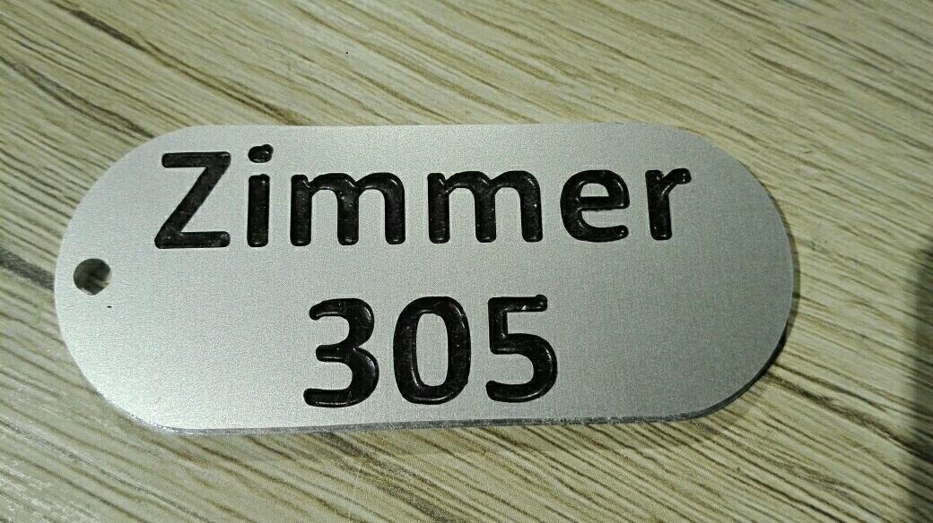 Schlüsselanhänger aus Aluminium für ein Nürnberger Hotel