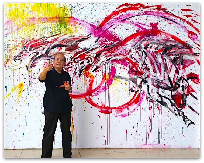 Artist Lum Weng Kong in front of his collaborative grafitti mural