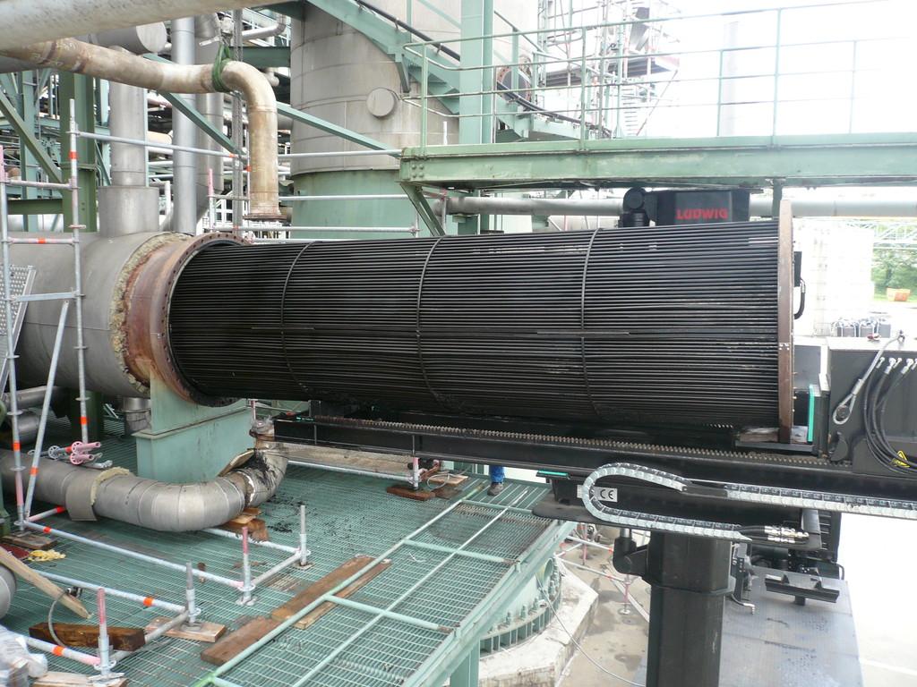 Extrator de feixes tubulares montado em caminhão: operação de extração