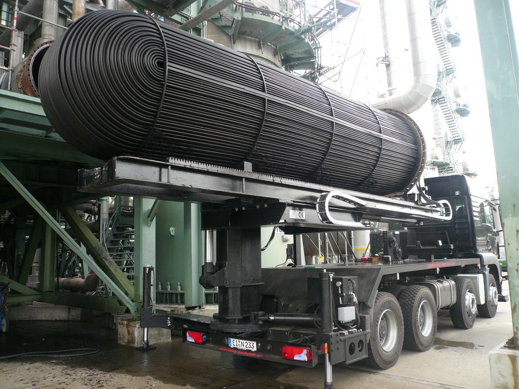 Extractor de haces montado sobre camión: intercambiador de calor asegurado sobre el camión