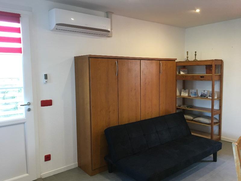 armoire lit double dans séjour