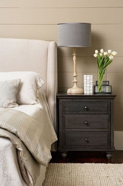 This greige coloured room looks beautifully staged with fresh tulips and a neutral colour scheme.