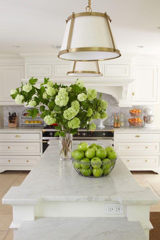 Carrera marble countertops and quartz look alikes are very popular.