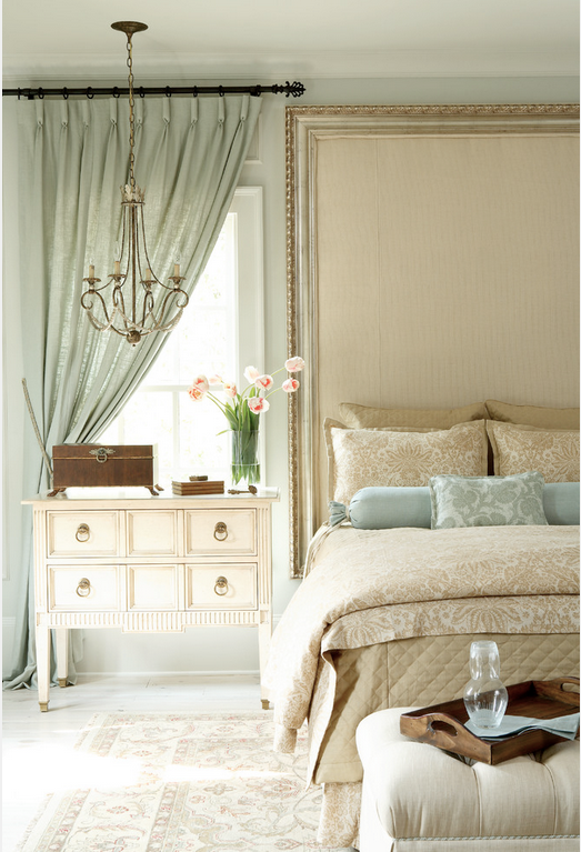 Roll-pleated tied back drapery suits this window beside a bed. Photo Attributed to: J. Hirsch Interior Design, LLC