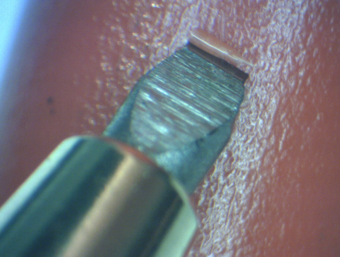 Close-up of flat scraper blade