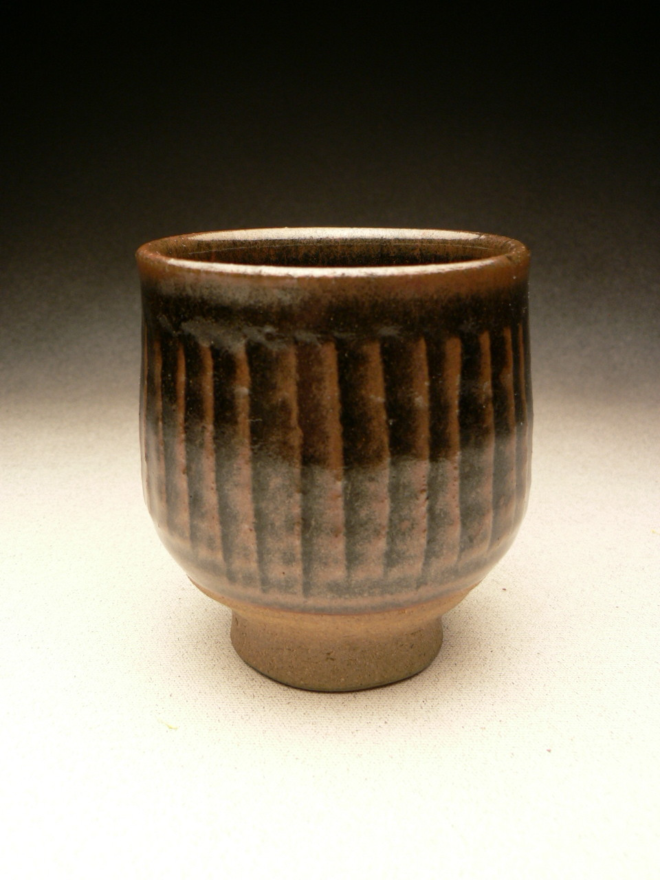 MIREK SMISEK - VINTAGE YUNOMI, STONEWARE, FLUTED, BROWN-BLACK TENMOKU GLAZE, POTTER'S STAMP - 9.5cmH x 9cmD, 0.2kg - NZ$110 - #MSR3.....SOLD