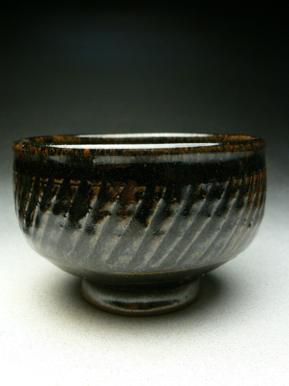 MIREK SMISEK - 10 TEA BOWLS - STONEWARE - CARVED FLUTING ON SIDES, TENMOKU GLAZE, ARTIST STAMP -  13cmD x 8.5 cmH - #SMR11 - $110NZD  EACH.