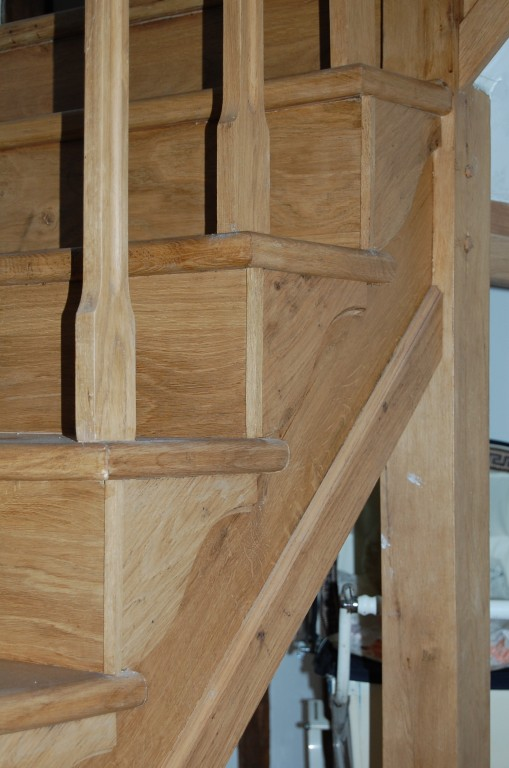 Close up on cut string and newel post