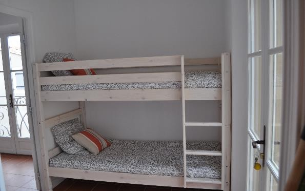 Sleeping area with bunk beds and wardrobe