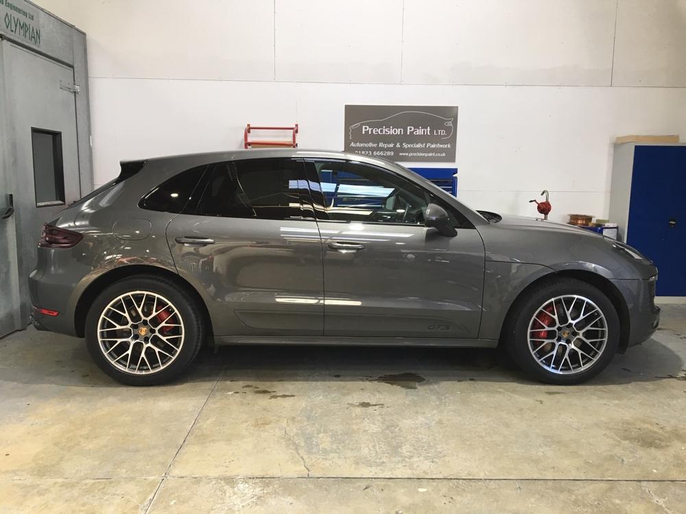Side View of Grey Porsche 4x4 in Precision Paint Workshop