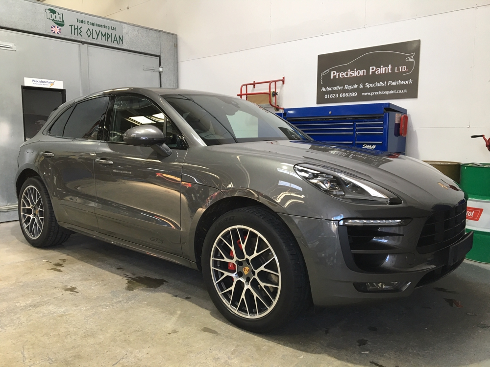Front Side View of Grey Porsche 4x4 in Precision Paint Workshop