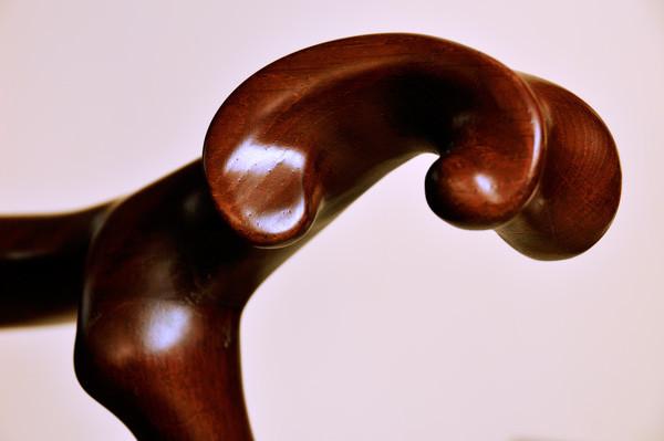 Detall del braç d'una cadira de braços