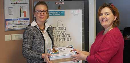 Christine de l'Association la Muse des gones et l'agence du Crédit Agricole de Saint-Didier-sur-Chalaronne, partenaire sponsor communication, en 2016