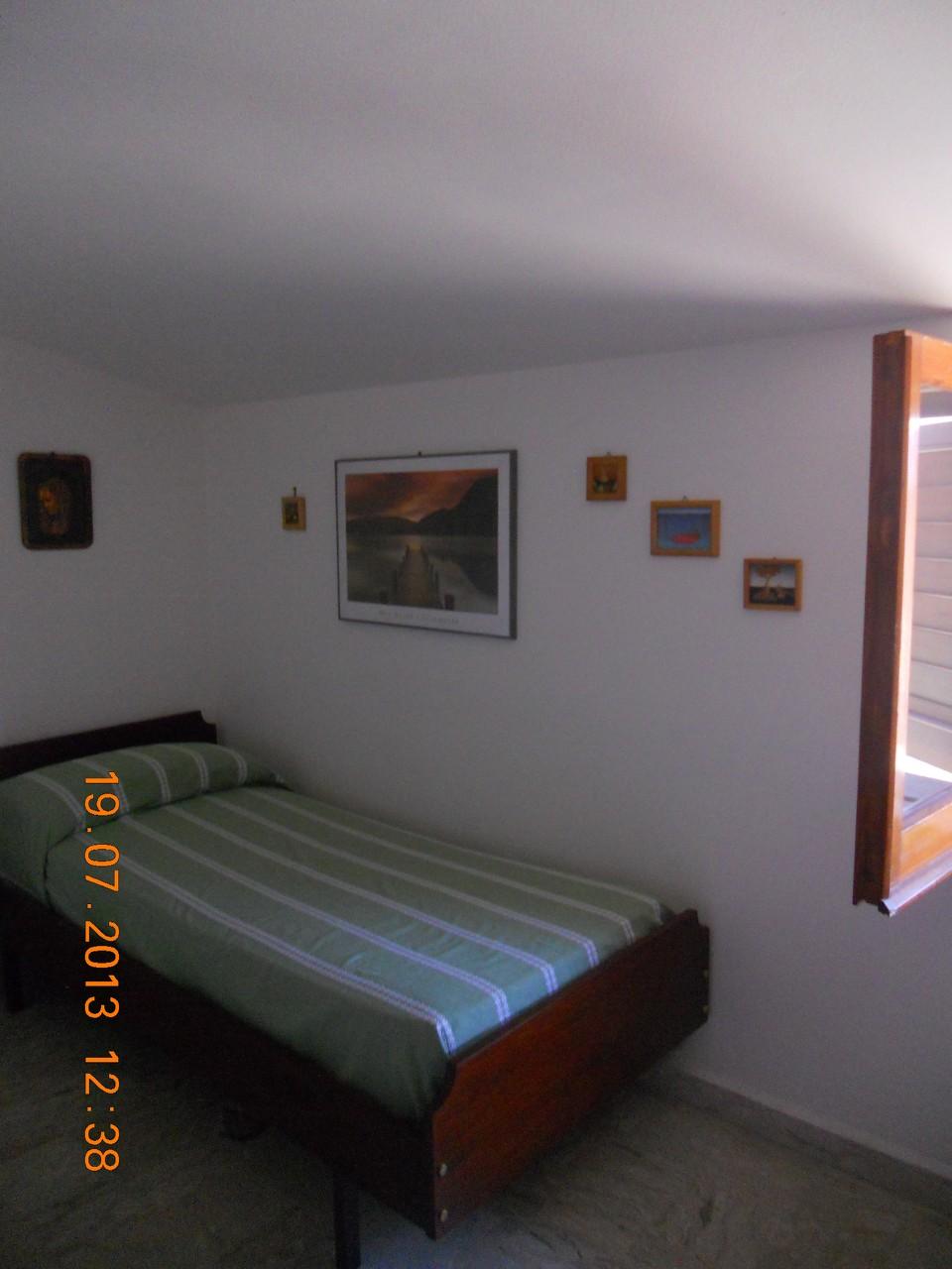 Tweede eenpersoonszolderslaapkamer.