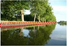 palplanche sur les berges d'un canal pouvant empêcher le passage (la remontée) des animaux essayant de le traverser