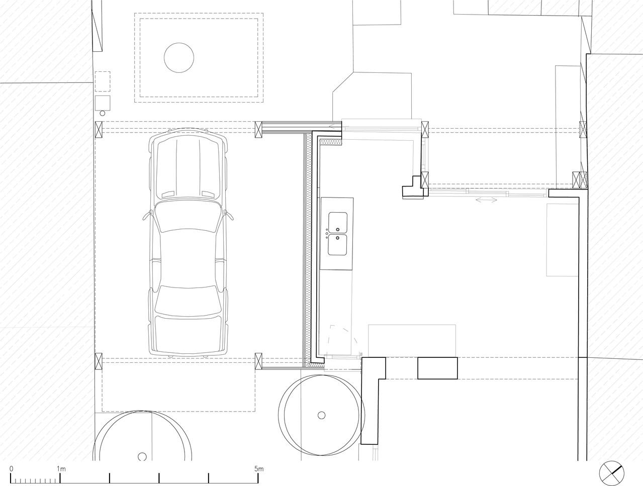 plan du rez-de-chaussée: porche stationnement, cuisine