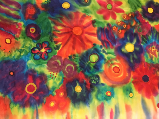 Colorful flowers represent joy on a silk flag
