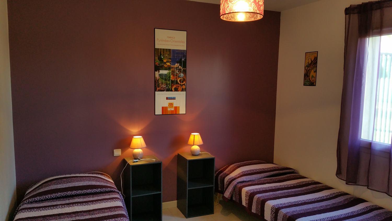 Chambre jusqu'à 3 lits simples ou 1 double et 1 simple du gîte Arbousier
