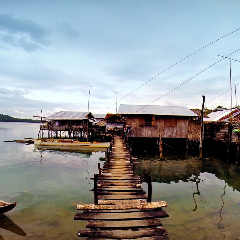 Local houses built on stilts over water in Siargao, Philippines © Sabrina Iovino | via @Just1WayTicket