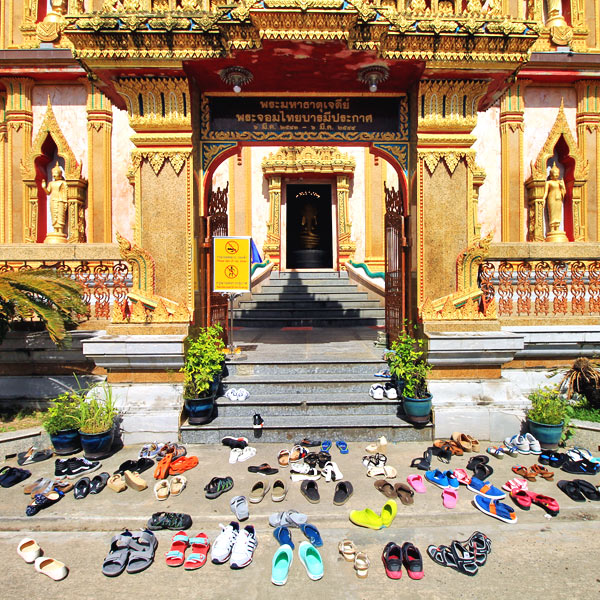 Shoes off at Wat Chalong | Travel Guide To Phuket: Things To Do in Phuket And Places To Stay | Phuket offers natural beauty, rich culture, white beaches, tropical islands and plenty of adventure activities | via @Just1WayTicket | Photo © Sabrina Iovino