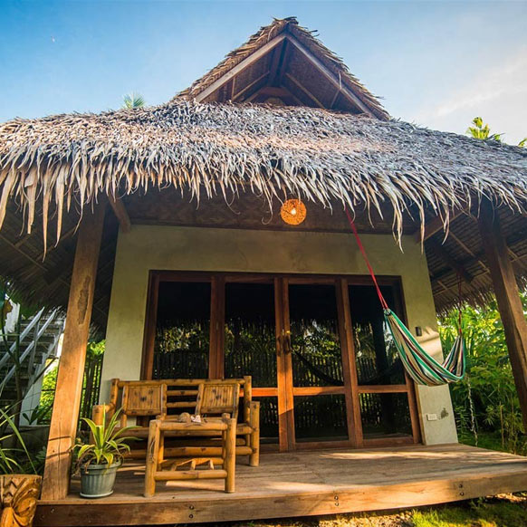 Tiki Bungalows in Siargao, Philippines © Dick Annerberg