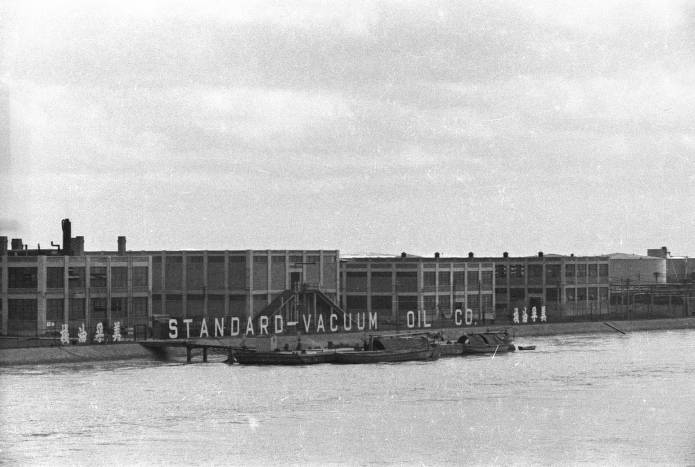 Standard-Vaccum Oil Co. Factory in Shanghai (source: https://collections.lib.uwm.edu/digital/collection/agsphoto/id/6518/ ). Located in Pudong on the Huangpu river across the Shanghai Bund it was opened in December 1929 and primarily produced candles.