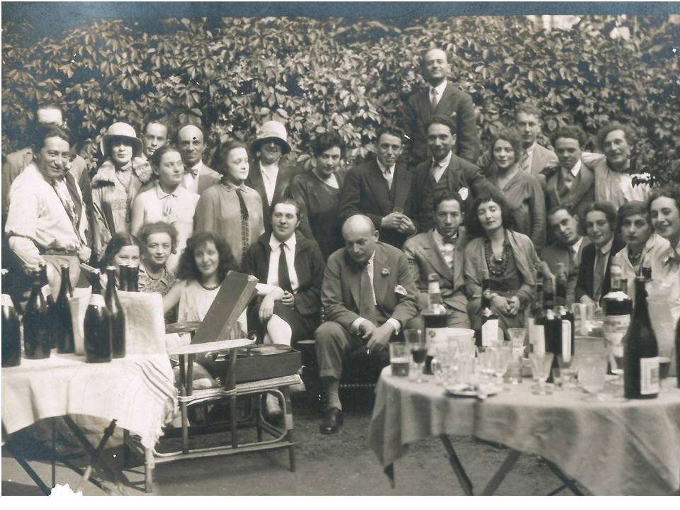 Theater people at Chagall's. Standing: 1st from the right – Chagall, 2nd – Zuskin, 6th from the left – Mikhoels. Sitting: 2nd from the right – Berkovskaya (my mother-to-be), 5th – Bela Chagall, 7th – Founder of the theater Granovsky. Country house outsid
