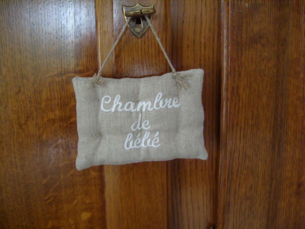 Coussin de porte for Decoration de porte en tissu