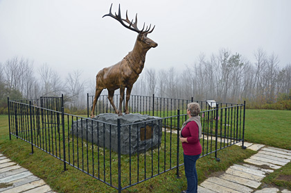 Elk on trail monument.