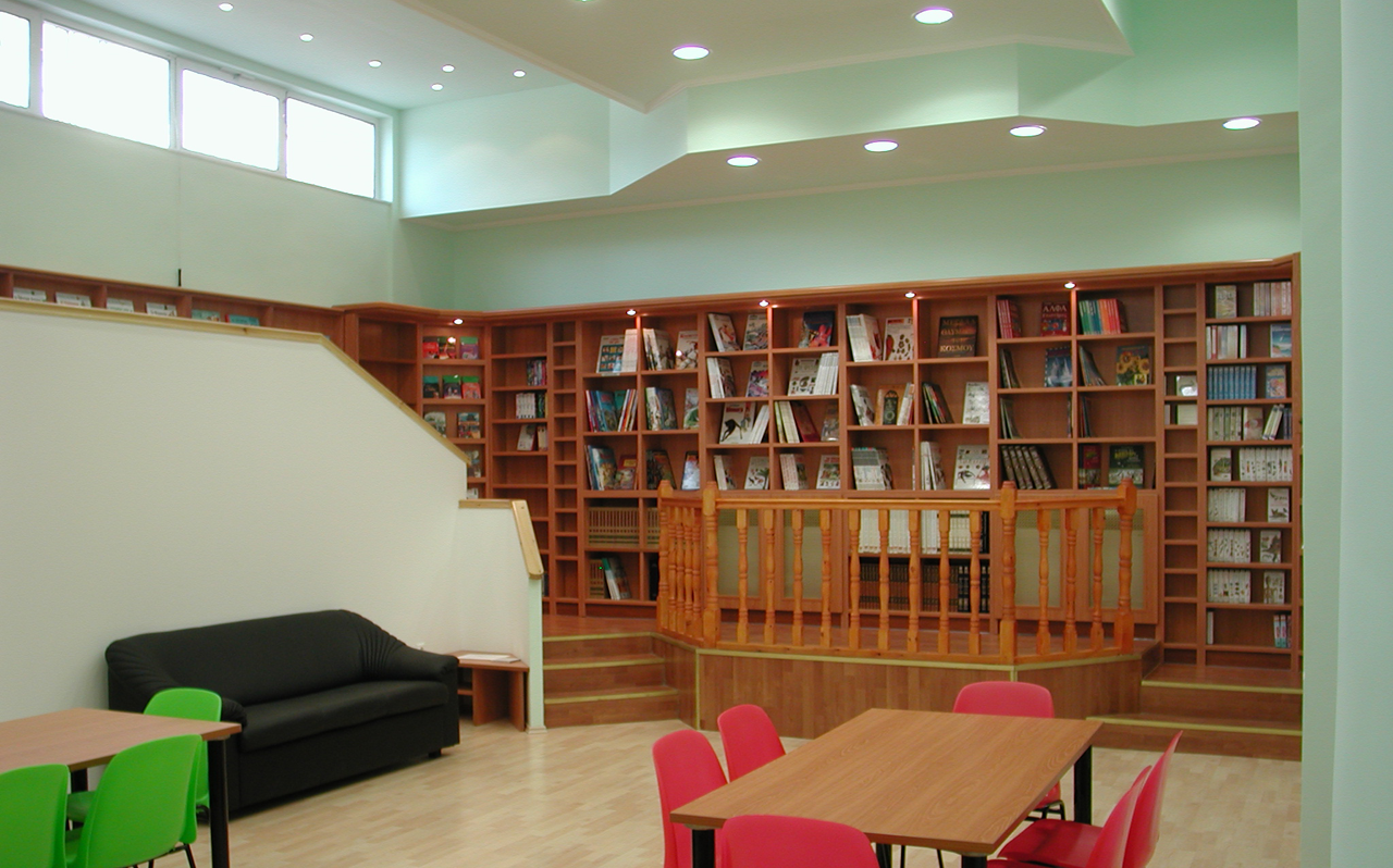 After. On the ground floor, functioning alternately as school library and study room or as art and culture hall.