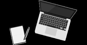 Notizbuch neben Laptop