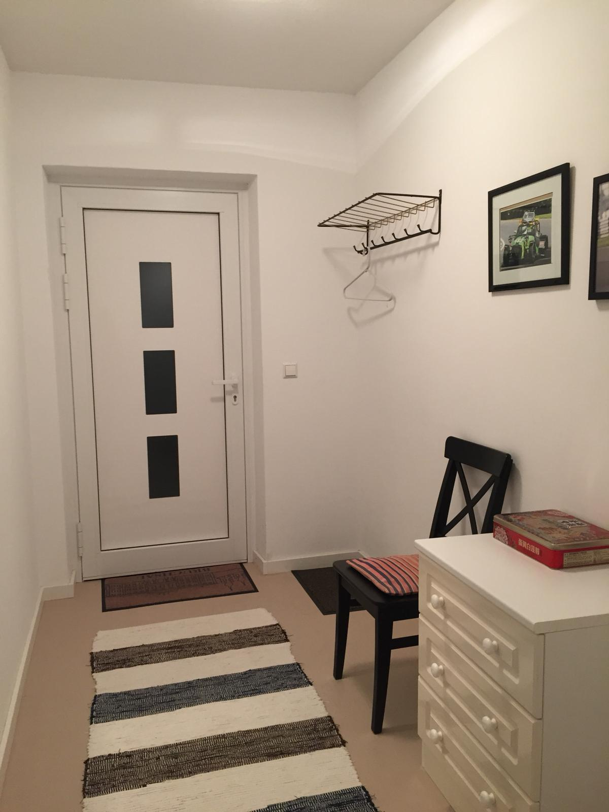 Spacious entrance hall for jackets and shoes