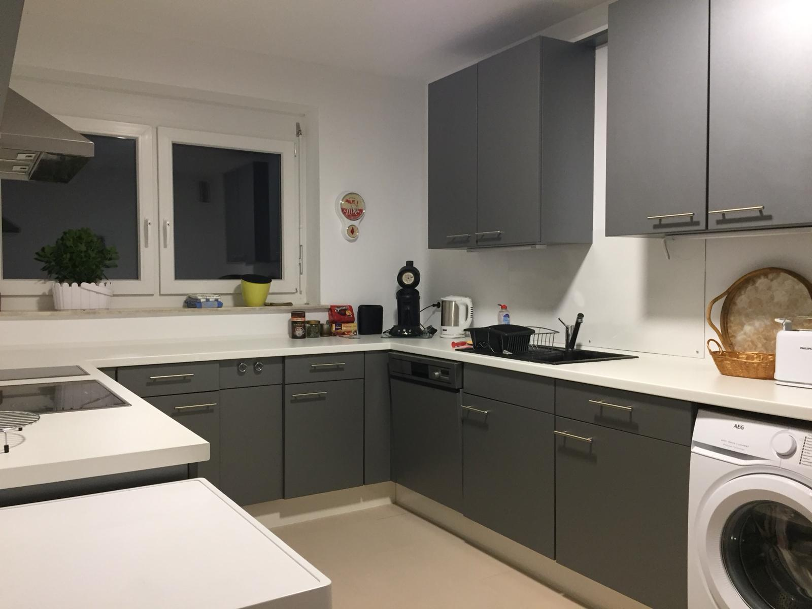 The washing machine is part of the kitchen
