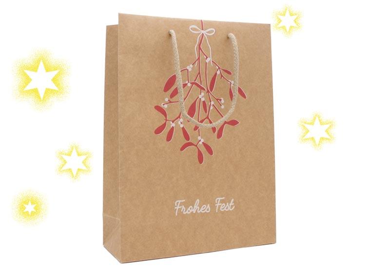 Weihnachtstragetasche Mistel aus Papier braun 200 Gramm mit Stoffkordel in beige bedruckt mit einem Mistelzweig und dem Schriftzug Frohes Fest günstig kaufen in der Größe 26 x 10 x 35 cm