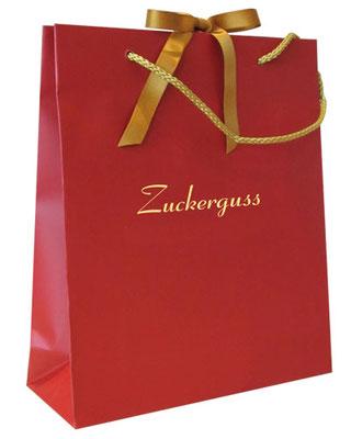 Papiertragetaschen als Geschenkverpackung