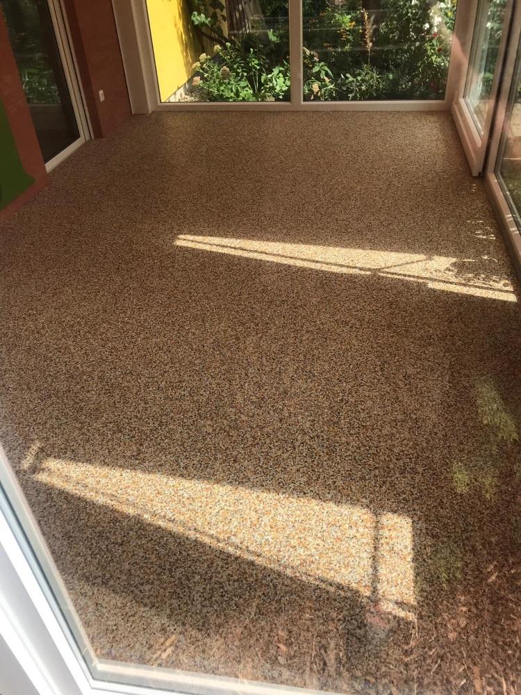 Steinteppich, der ideale Fußbodenbelag für Wintergarten