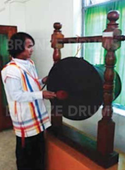 Fig. 6. Playing a drum in the Kayah museum with Kayah colored jacket