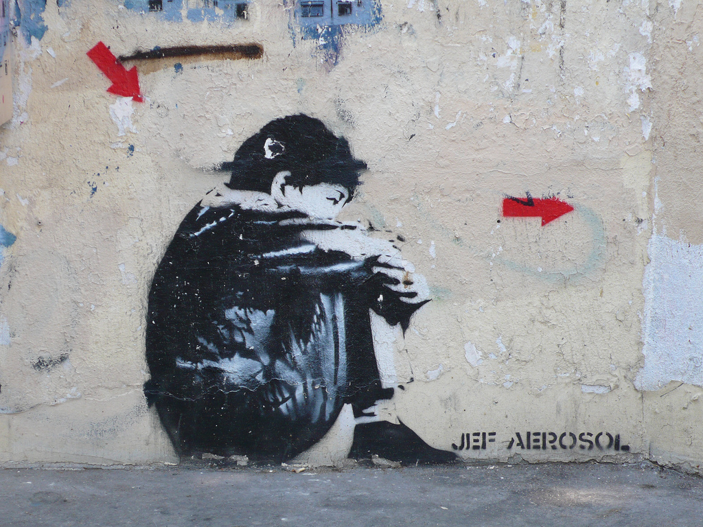 pochoir street art jef aérosol sitting kid