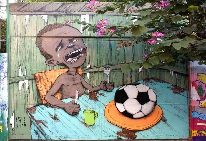 paulo-ito-street-art-footbla-denonciation-business-bresil-coupe-du-monde-pauvrete.jpg
